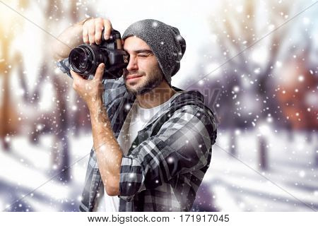 Professional photographer taking picture of beautiful winter landscape