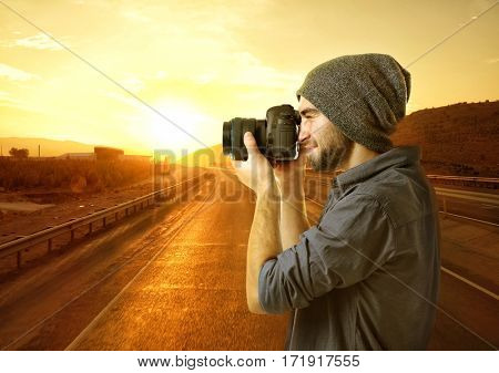 Photographer taking picture of beautiful landscape