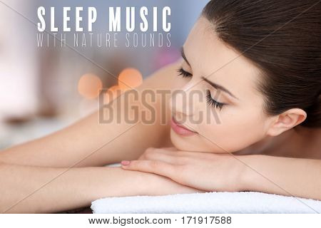 Concept of music for sleep and meditation. Young woman relaxing at spa salon