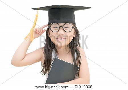 Asian school kid graduate thinking and smile with graduation cap isolated on white background