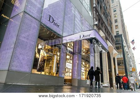 New York February 9 2017: People walk by the Dior store on 57th street following a snowfall in Manhattan.