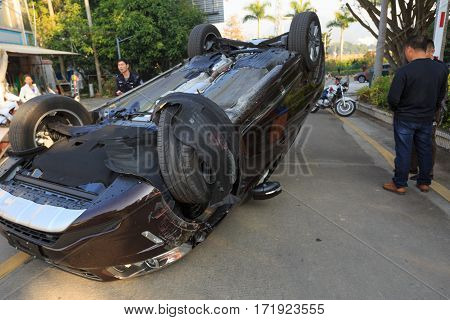 Shenzhen, China - FEBRUARY 17: Car turned upside-down by accident on road,on February 17, 2017