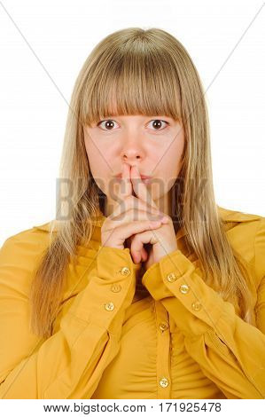 Pretty woman in yellow shirt showing silence gesture