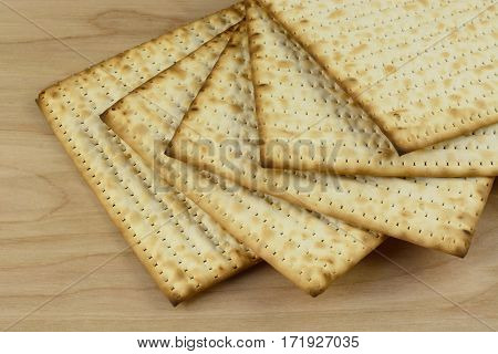 Stack of kosher egg matzo bread on wooden table
