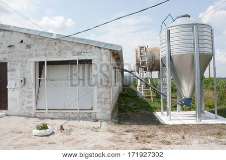 The building of the poultry farm and a bunker with food