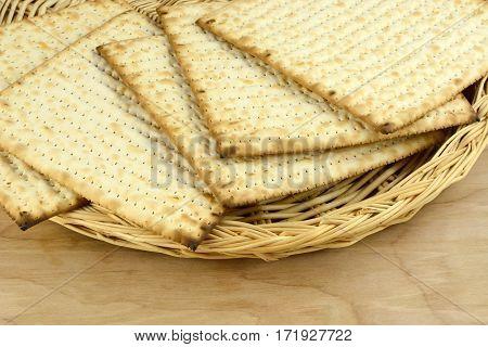 Stack of kosher egg matzo bread in wicker plate