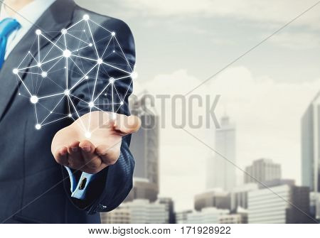 Businessman hand showing digital connection lines on city landscape