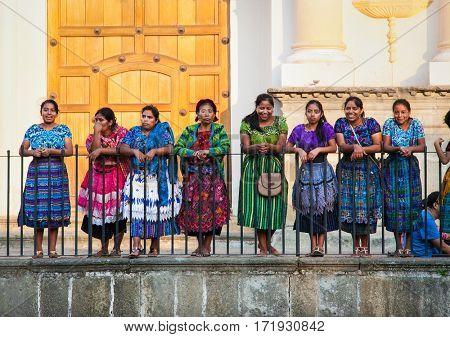 ANTIGUA, GUATEMALA-DEC 26, 2015: : Guatamalian woman drasing in traditional dresses at the street of Antigua, on Dec 26, 2015, Guatemala.