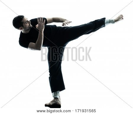 one caucasian man krav maga fighters fighting isolated silhouette on white background