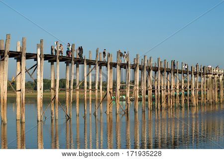 AMARAPURA, MYANMAR - DECEMBER 20, 2016: Evening on the bridge of U bein bridge