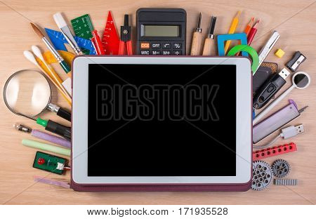 Tablet Pc Over School Supplies Or Office Supplies On School Table. Background With School Or Office