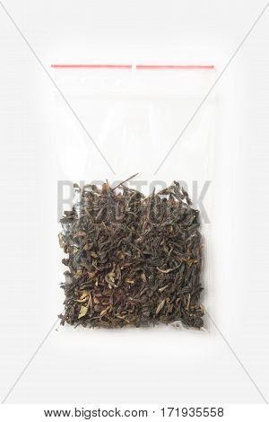 Plastic Transparent Zipper Bag With Half Dried Darjeeling Black Tea Isolated On White, Vacuum Packag