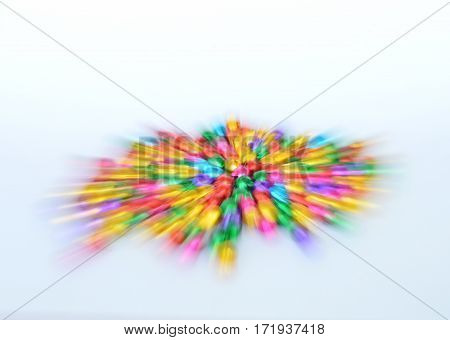 blurry colorful bell spread by zoom technique on white background
