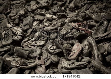 OSWIECIM POLAND - AUG 18: Boots of victims in Auschwitz the biggest concentration camp in Europe on August 18 2015 in Oswiecim Poland.