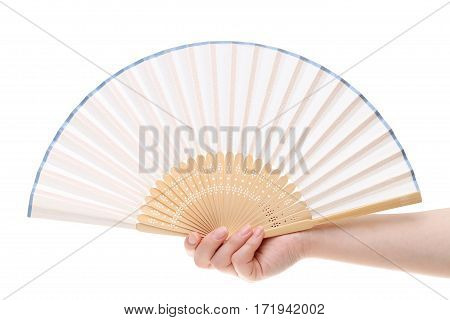 Hand holding chinese fan on a white background