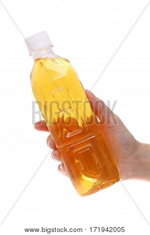 Hand holding bottle of tea isolated on white background