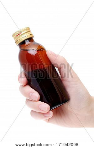 Hand holding brown medicine bottle isolated on white background