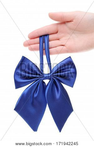 Hand holding bow tie for woman isolated on white background
