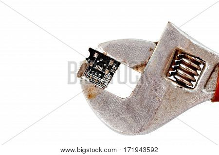 Image Of A Macro Shot Of Piece Of A Circuit Board Pressed With Pipe Wrench
