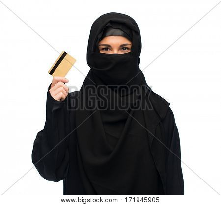 finances and people concept - muslim woman in hijab with credit card over white background
