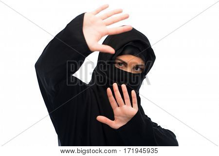 religious and people concept - muslim woman in hijab showing stop sign over white background