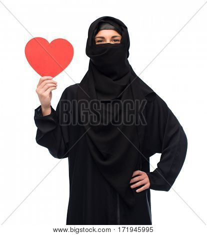 love, charity, valentines day and people concept - muslim woman in hijab holding red heart over white background