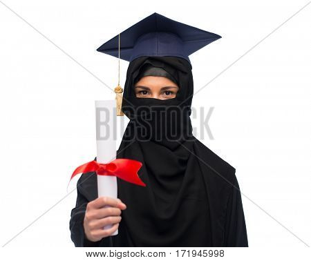 education, graduation and people concept - muslim woman in hijab and mortarboard with diploma over white background