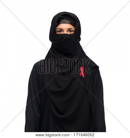 aids, hiv, healthcare and people concept - muslim woman wearing hijab and red awareness ribbon