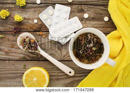 Tea with herbs, lemon, medicine. Top view.