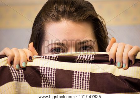 Shy Cute Lovely Young Woman With Lying In Bed And Hiding Her Face