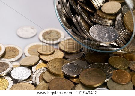 Business finance. Save money for investment concept.Different coins money in the glass piggy box.
