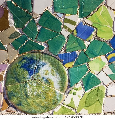 Broken glass mosaic tile decoration in Park Guell, Barcelona, Spain.