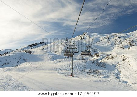 View Of An Alpine Ski Slope With Chairlift
