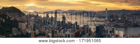Sunrise ( day to night shot) over Victoria Harbor as viewed a top Victoria Peak with Hong kong and Kowloon below China