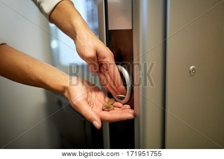 sell, technology, people, finances and consumption concept - hands with euro coins at vending machine