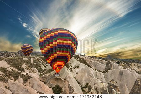 balloons in mountain landscape, Cappadocia, Goreme, Turkey