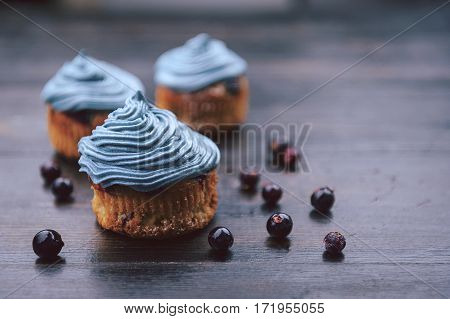 Muffin With Currants On A Dark Background Next To The Berries On The Branches. In A Rustic Style. Da