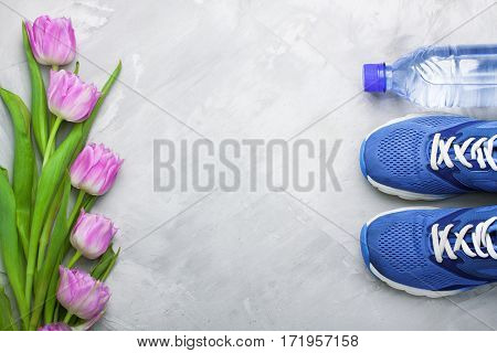 Spring Flatlay Composition With Sneakers And Tulips.