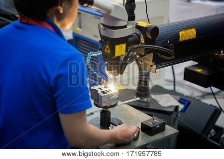 Technical Specialties and engineer repair mold and die part by Laser welding machine production worker and factory job Spot welding Industrial automotive in thailand