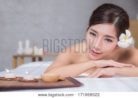 The girl relaxes in the spa salon with hand massage poster