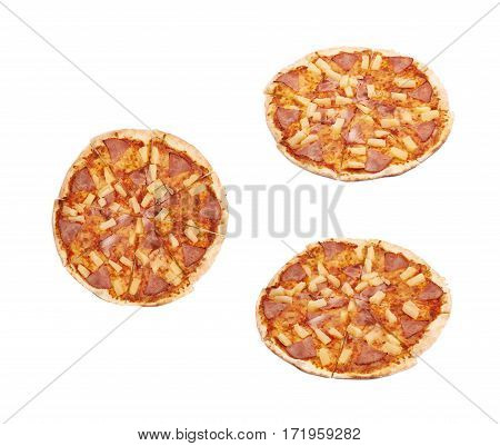 Whole hawaiian pizza sliced, composition isolated the white background, set of three different foreshortenings