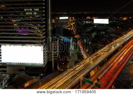 White billboard and cityscape expressway with traffic in Bangkok city with building and transportation from Skyscraper.