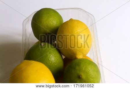 Beauty limes and lemons on neutral background