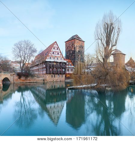Winter Henker haus and Henkersteg bridge over Pegnitz river in Nuremberg, Bavaria, Germany