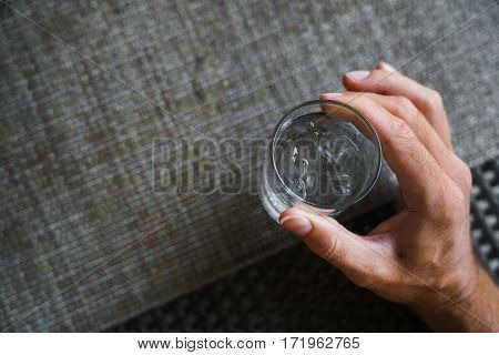 Glass of very cold water in man's hand transparent glass. Quench their thirst.