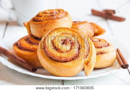 Homemade traditional swedish sweets cinnamon rolls on white plate