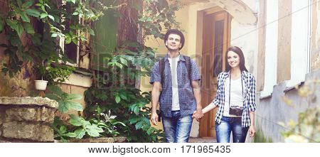 Couple of young travelers: walking around old town. Vacation, summer, holiday, tourism: concept.