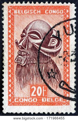 BELGIAN CONGO - CIRCA 1948: a stamp printed in Belgian Congo shows Mbowa executioner's mask with buffalo horns Baluba tribe circa 1948