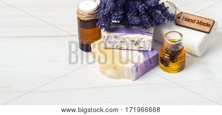 Spa concept. Lavender handmade soap and accessories for body care (lavender soap towel oil )