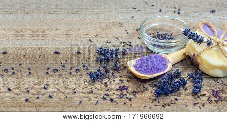 Lavender handmade soap and sea salt on a wooden background.